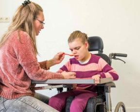 caregiver assisting a child