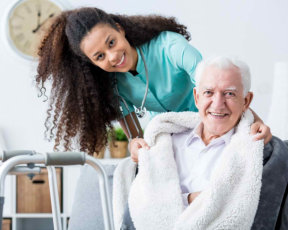 Smiling doctor caring about patient at home